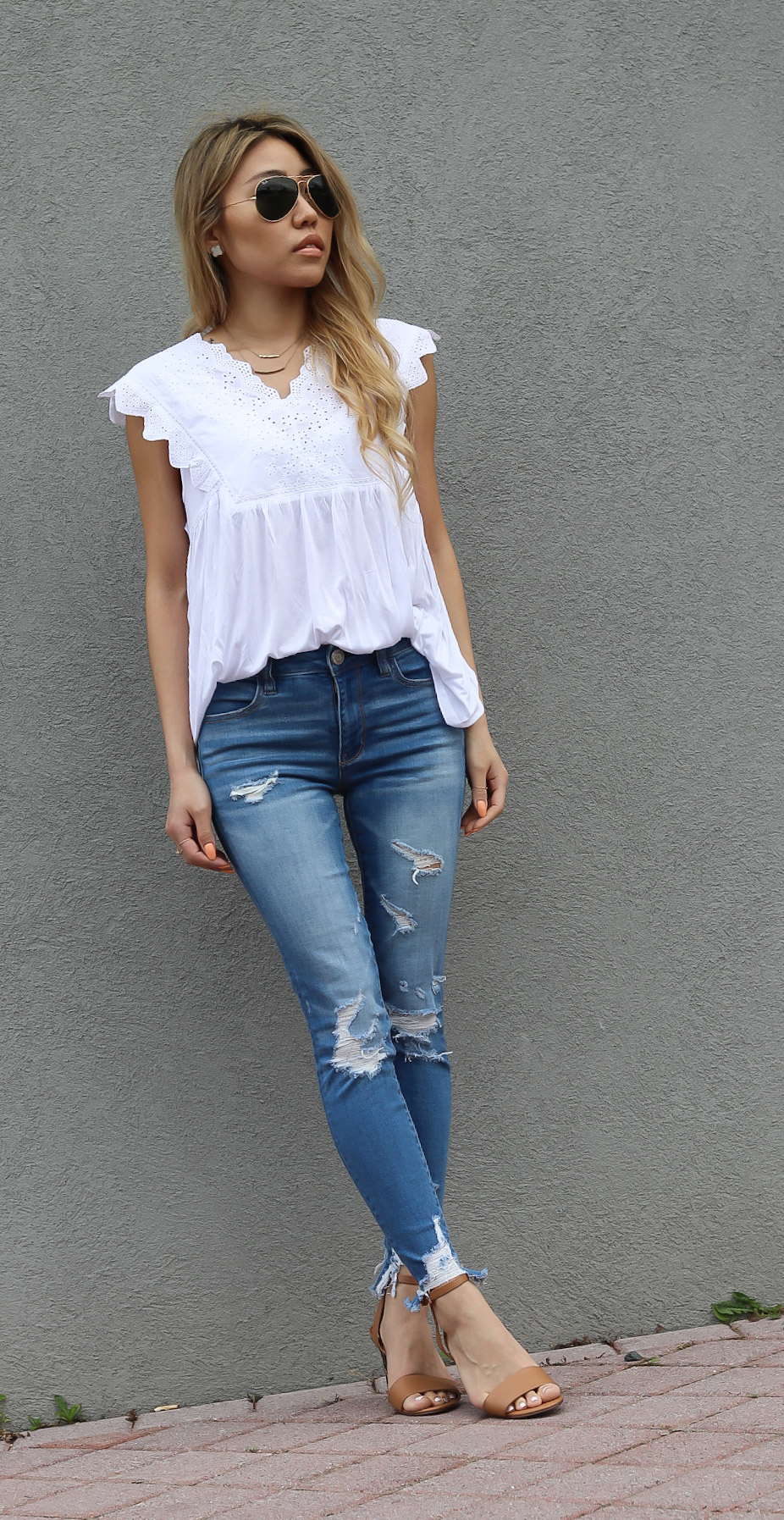 148076f2589 Eyelet detailed clothing is one of my favorites to wear in warmer seasons  like Spring and Summer and I think everyone needs one in their closet.